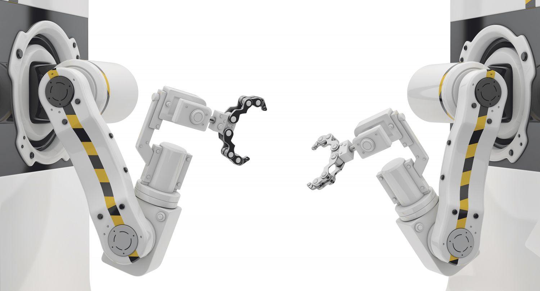 Zwei Roboter richten ihre Greifarme aufeinander