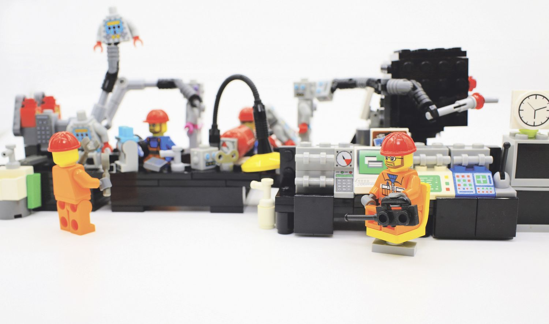 Bauarbeiter-Legofiguren bei der Arbeit